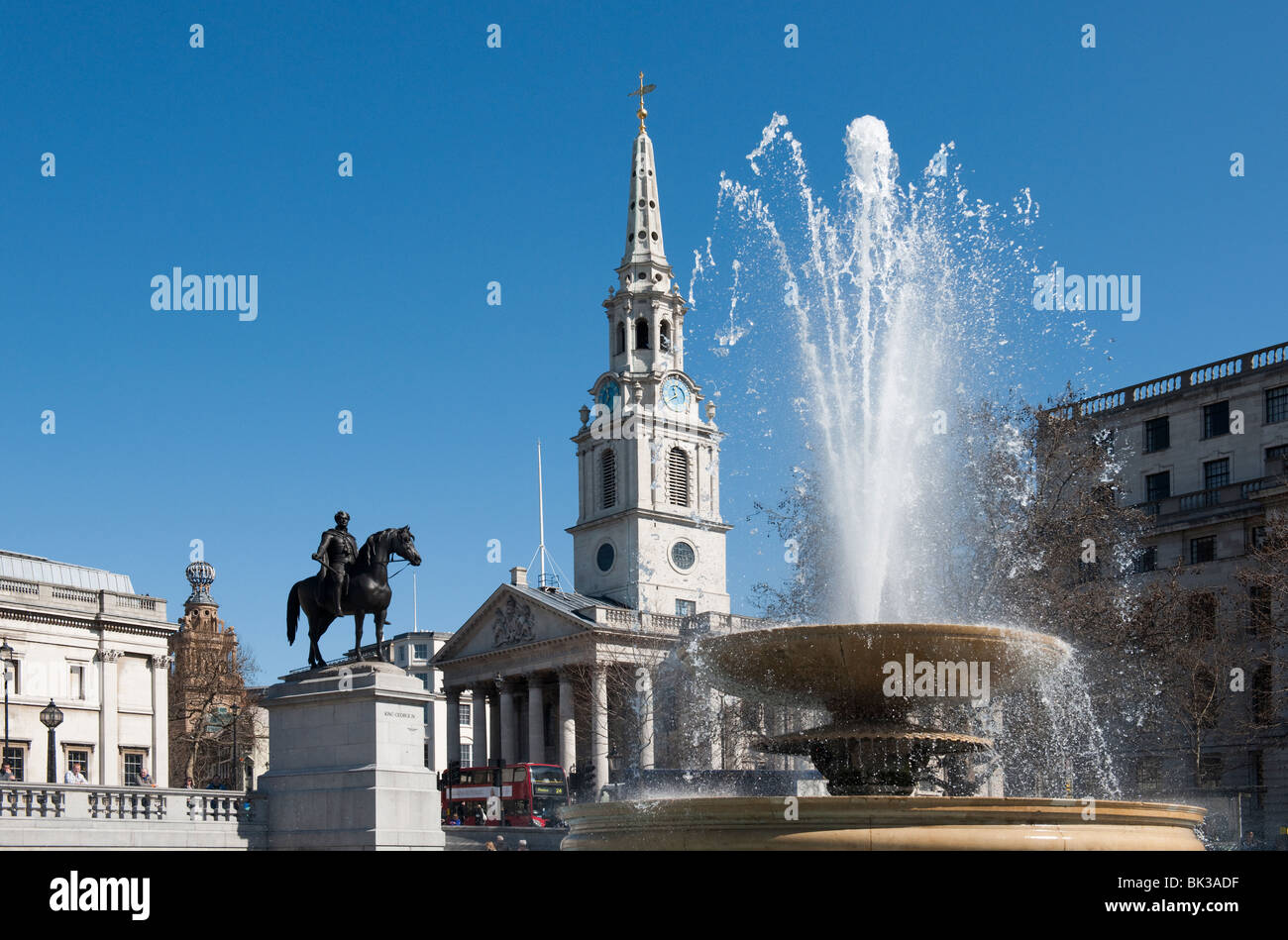 Saint Martin's in the Fields, Fountain & Statue of King George IV in Trafalgar Square London - Stock Image