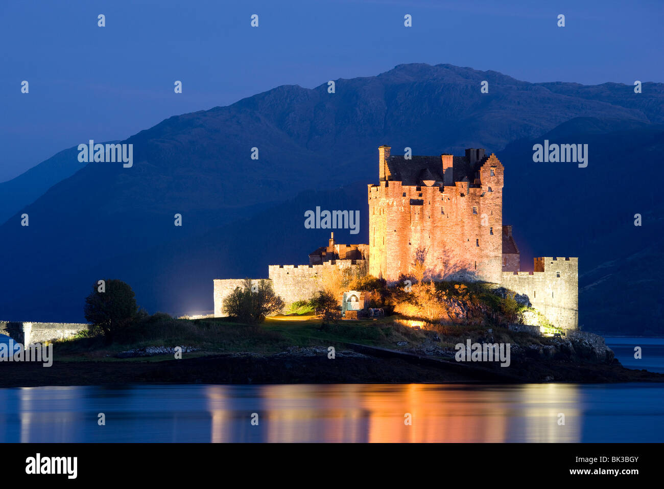 Eilean Donan Castle floodlit at night on Loch Duich, near Kyle of Lochalsh, Highland, Scotland, United Kingdom, - Stock Image