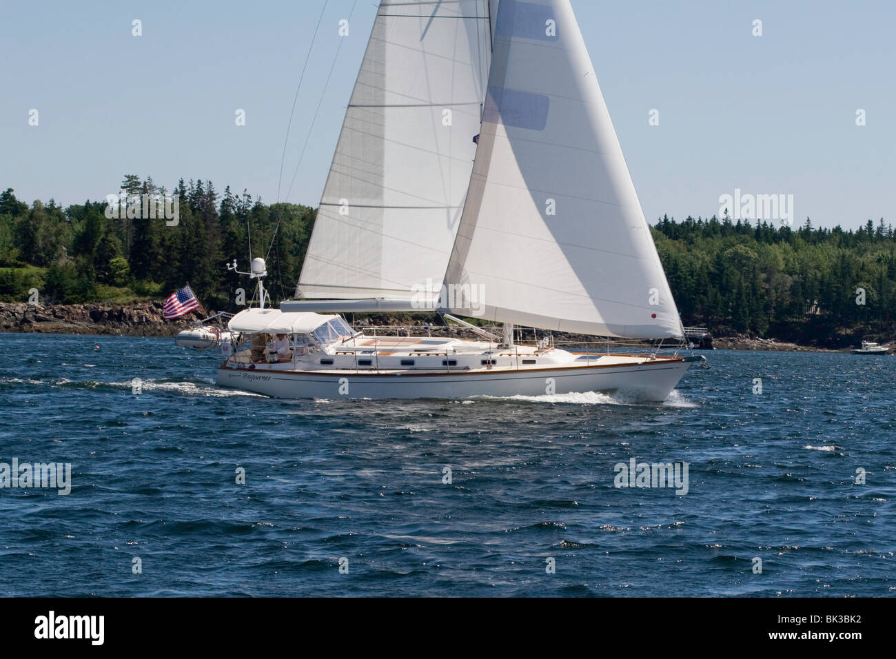 A Tartan 4600 sails into Rockland Harbor, Maine - Stock Image