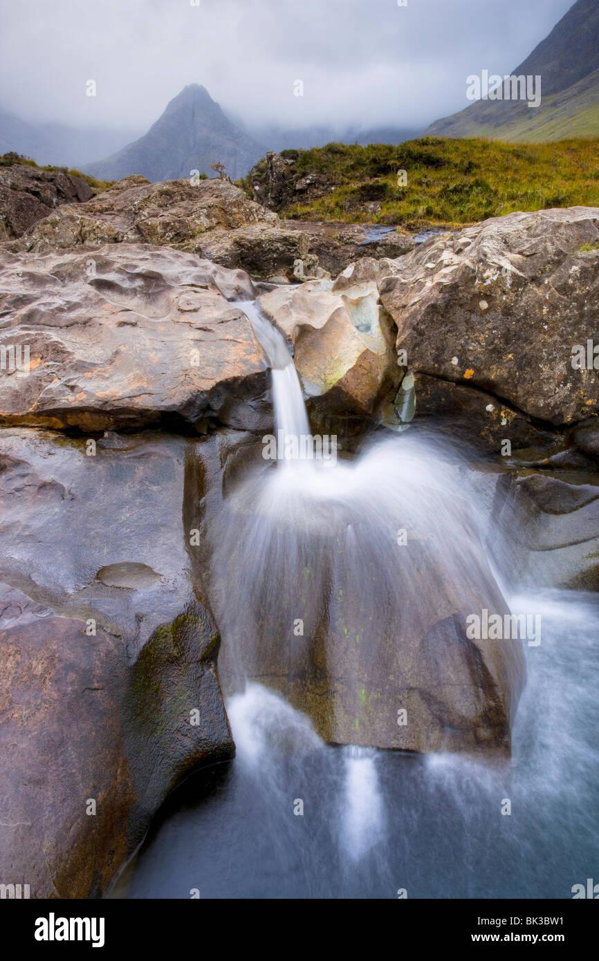 Water cascading over rocks, Fairy Pools, Glenbrittle, Isle of Skye, Highland, Scotland, United Kingdom, Europe - Stock Image