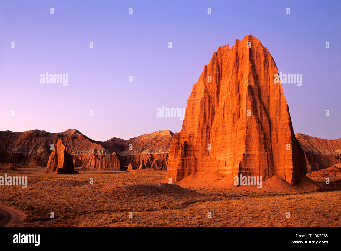 Pre-dawn light illuminates the Temple of the Sun and Temple of the Moon in upper Cathedral Valley in Capitol Reef Stock Photo