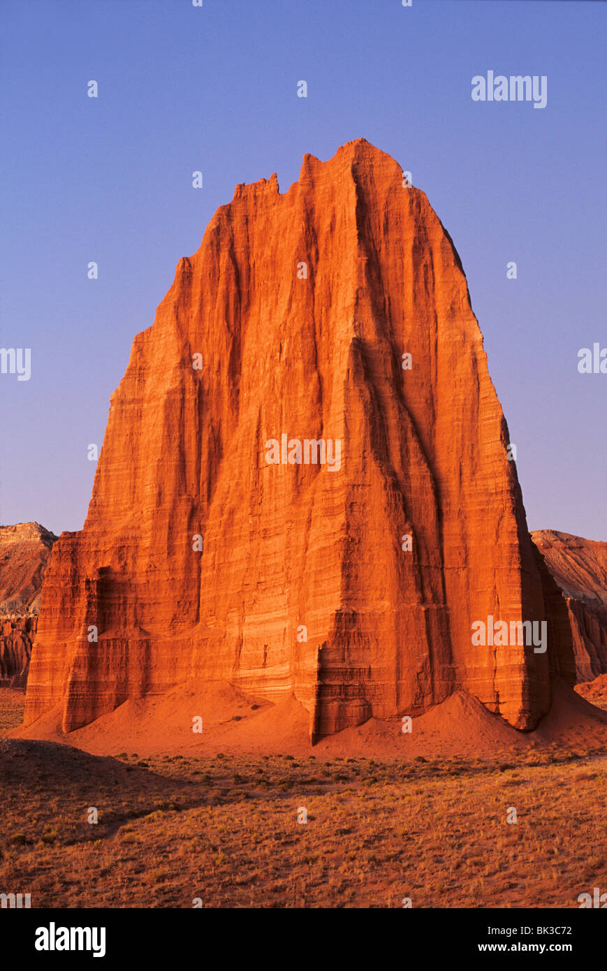 Pre-dawn light illuminates the Temple of the Sun in Cathedral Valley, Capitol Reef National Park, Utah. Stock Photo