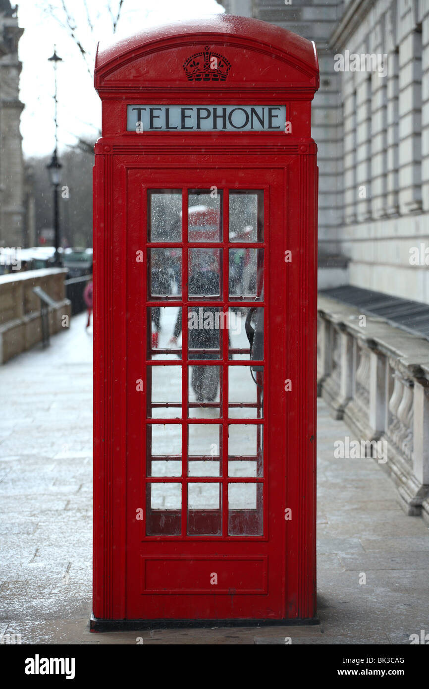 Traditional Red Telephone Box in central London, Westminster. - Stock Image