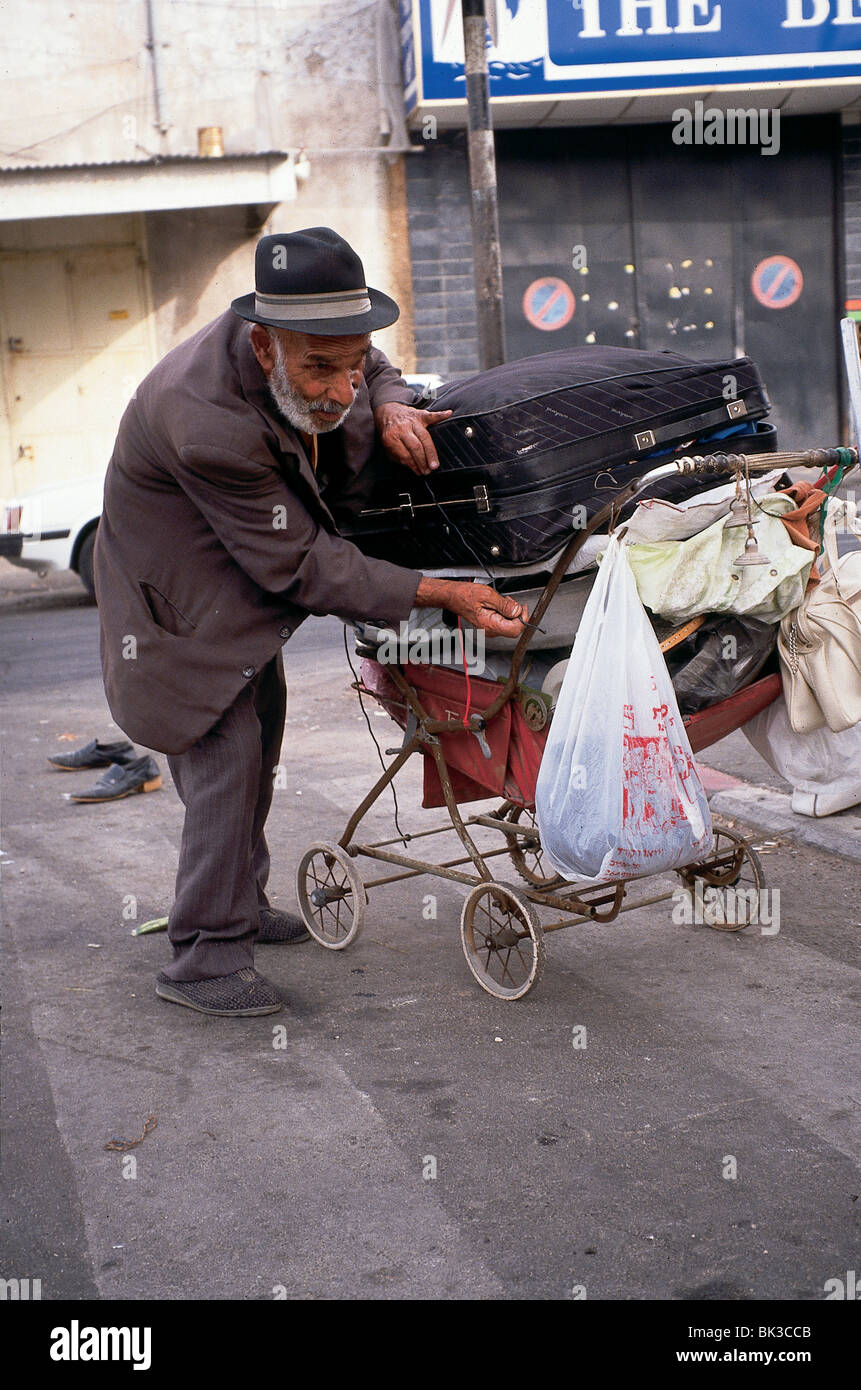 A man with his possessions in a stroller, Israel - Stock Image