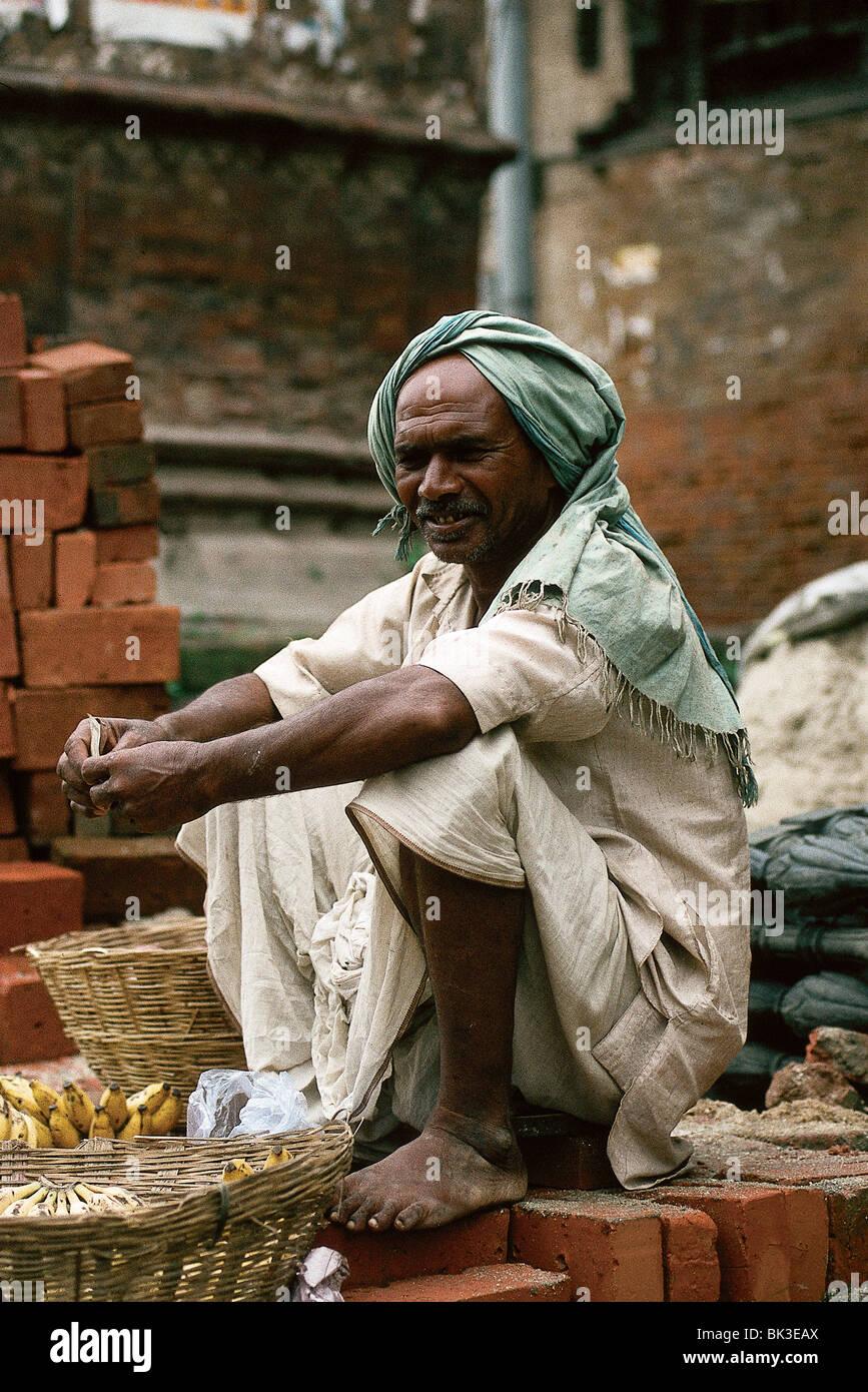 Food vendor with baskets of bananas, Kathmandu, Nepal - Stock Image