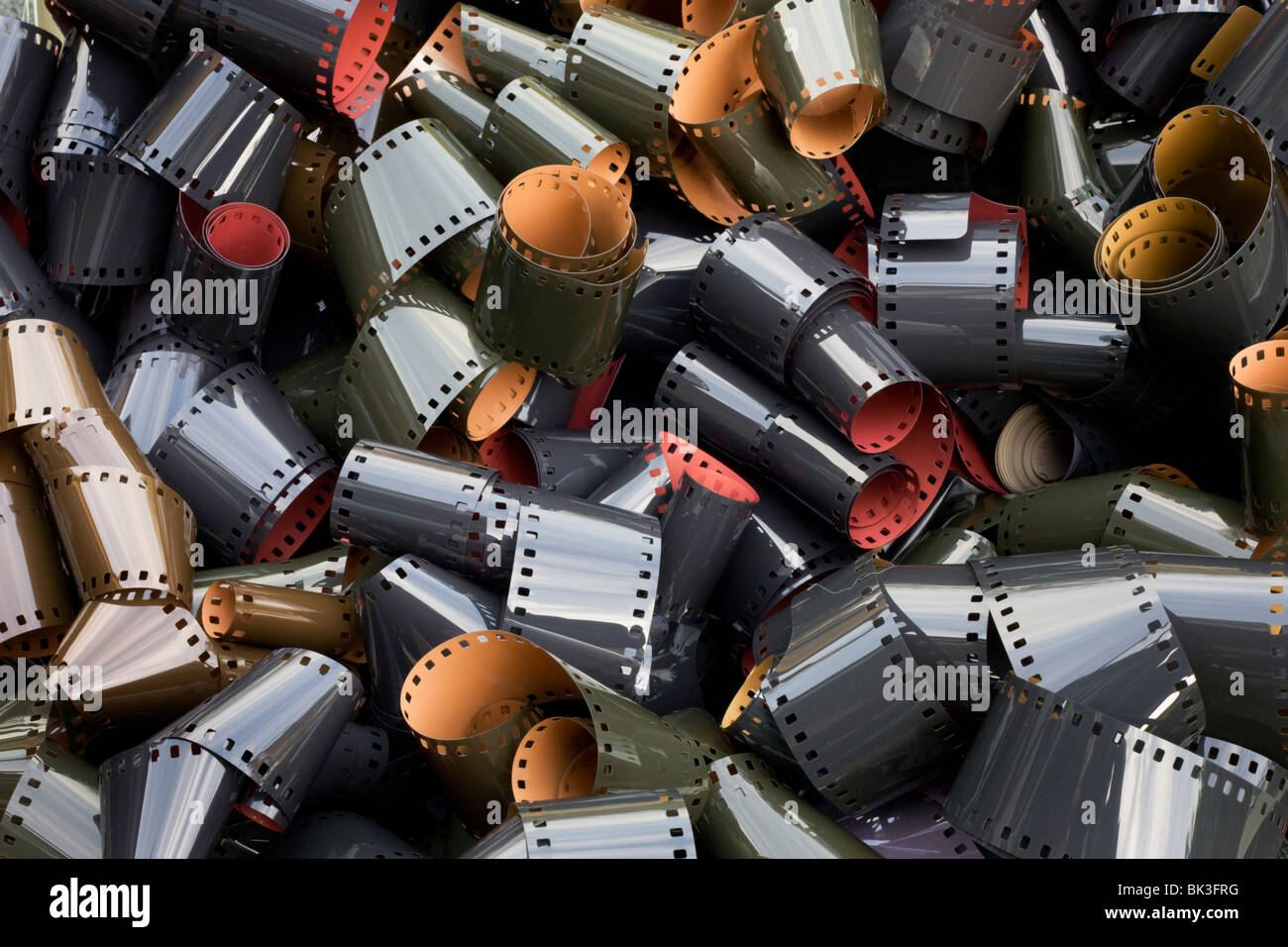 Coils of undeveloped, generic 35mm film emulsion, an antiquated analogue technology replaced by the digital camera - Stock Image
