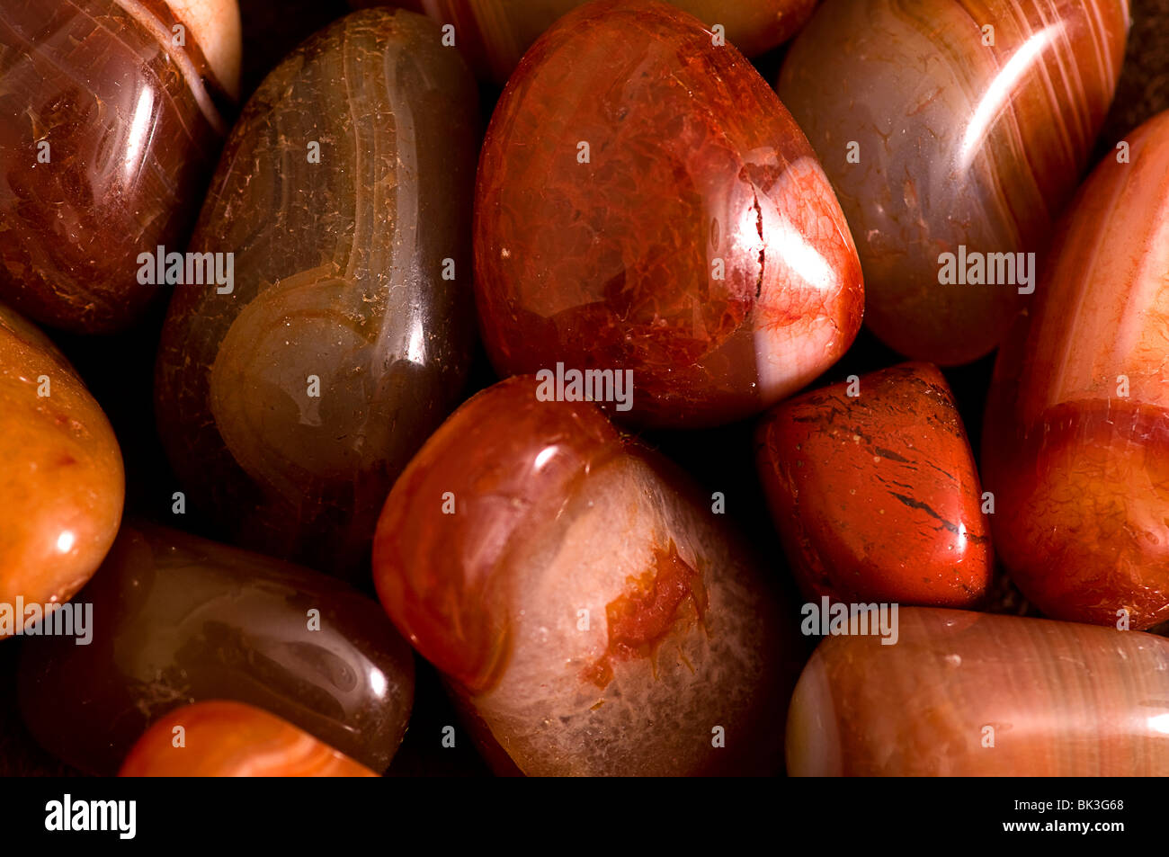 Brown crystals and polished stones - Stock Image