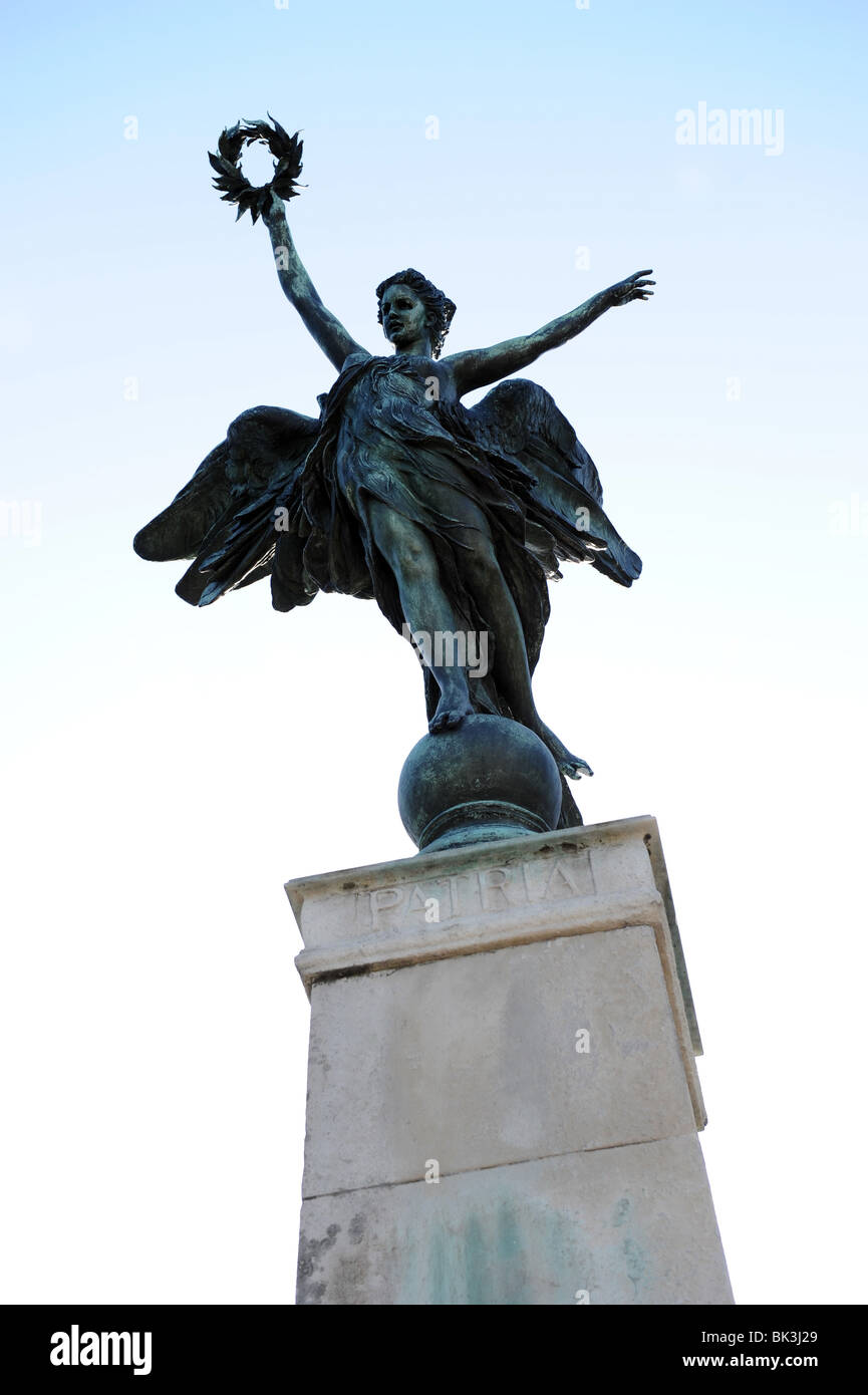 Angel Statue holding a Wreath, War Memorial - Stock Image