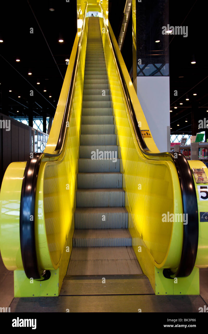 Bright yellow escalator inside the downtown branch of Seattle Public Library, Seattle, Washington - Stock Image