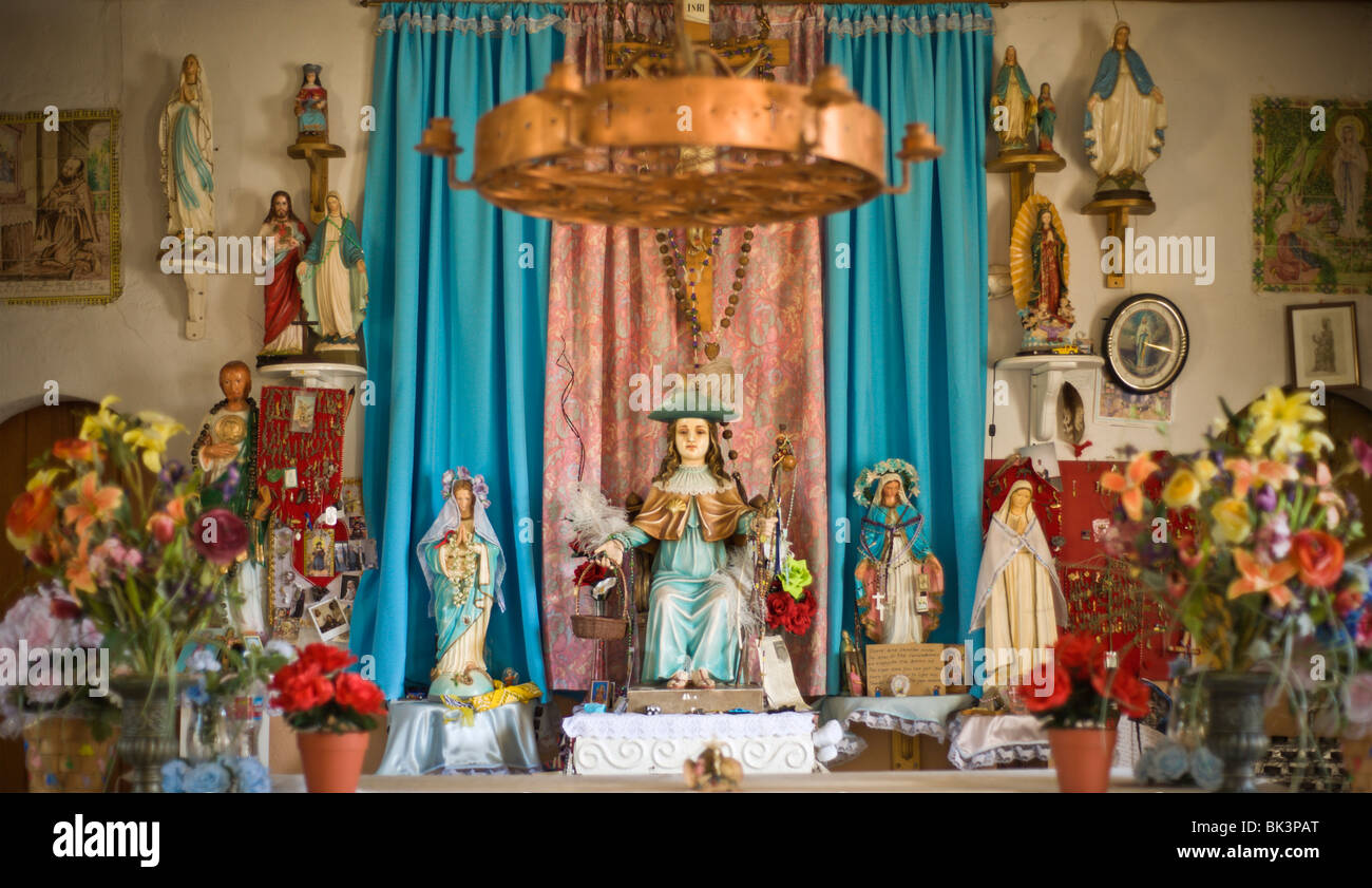 The scene at the alter of the Santo Nino de Atocha church, built in 1911, near Three Rivers, New Mexico. - Stock Image