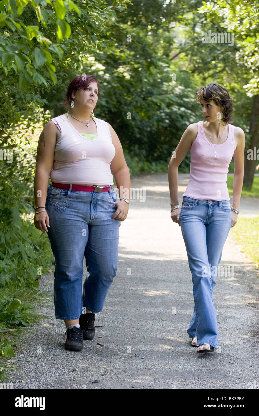 Obese And Skinny Women Walking Routine In Park And Chatting Full