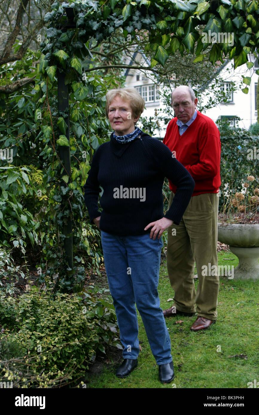 Senior couple argument in back garden - Stock Image