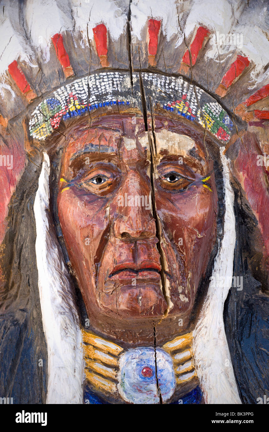 A cracked cigar-store Indian stands as a relic of times past at Three Rivers Trading Post, New Mexico. - Stock Image