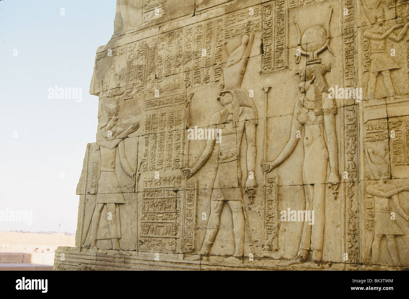 Bas-relief sculpture with depictions of the Egyptian god Horus and goddess Hathor, Egypt - Stock Image