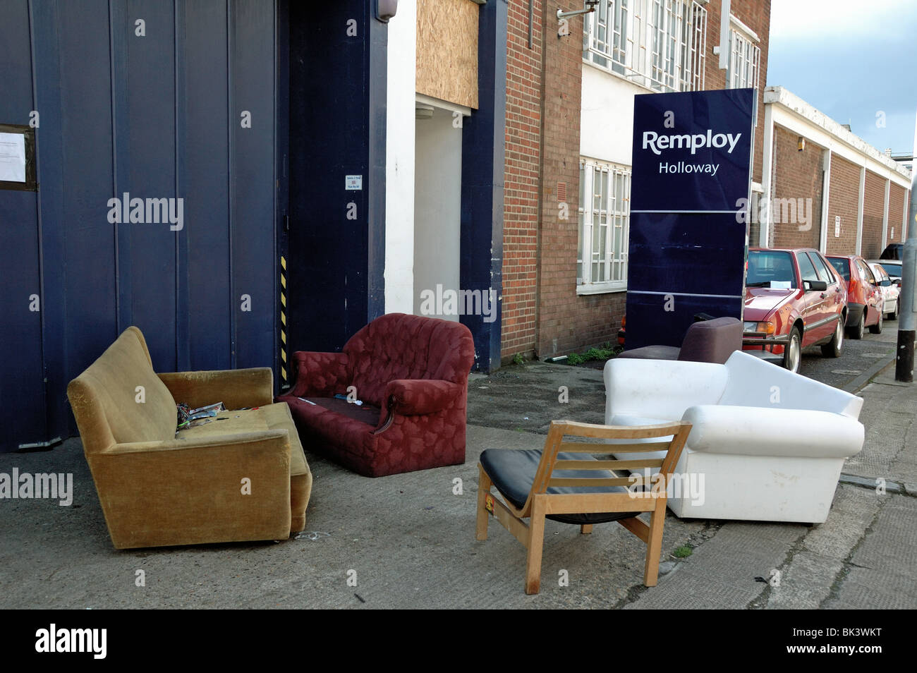 Furniture in street after squatters eviction from the closed Remploy building Holloway London England UK & Furniture in street after squatters eviction from the closed Remploy ...
