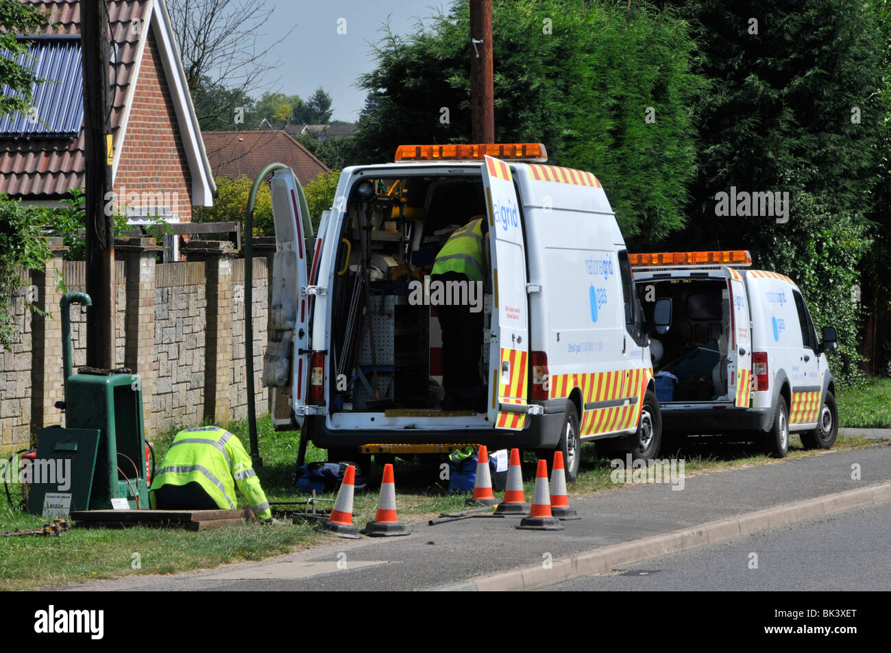 Gas national grid workmen and vans - Stock Image