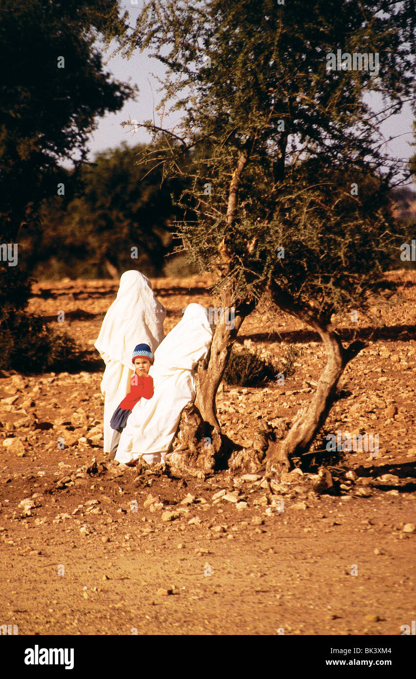 Two women and a child near Marrakech, Morocco - Stock Image