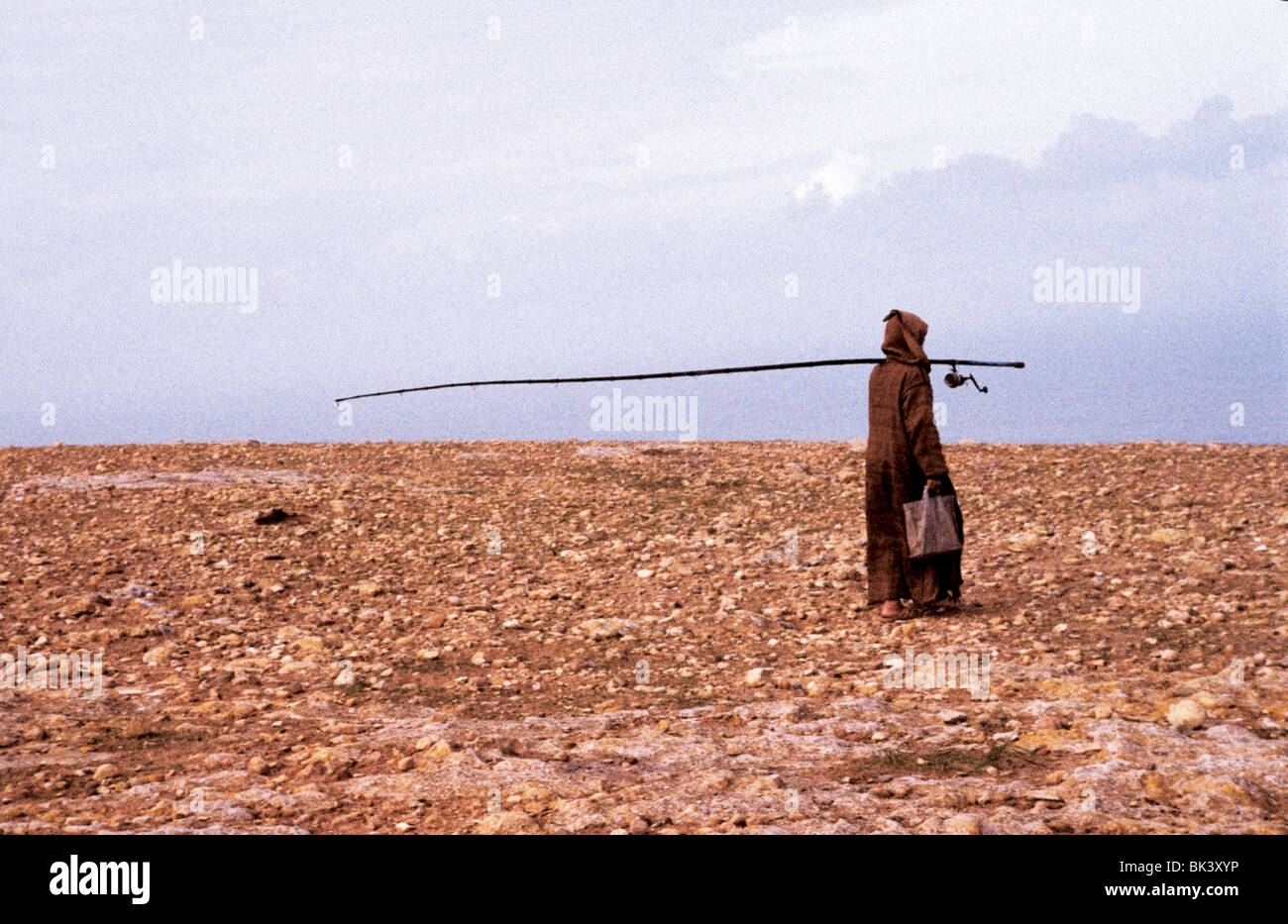 Man with fishing rod along the Atlantic coast, between Safi and Casablanca, Morocco - Stock Image