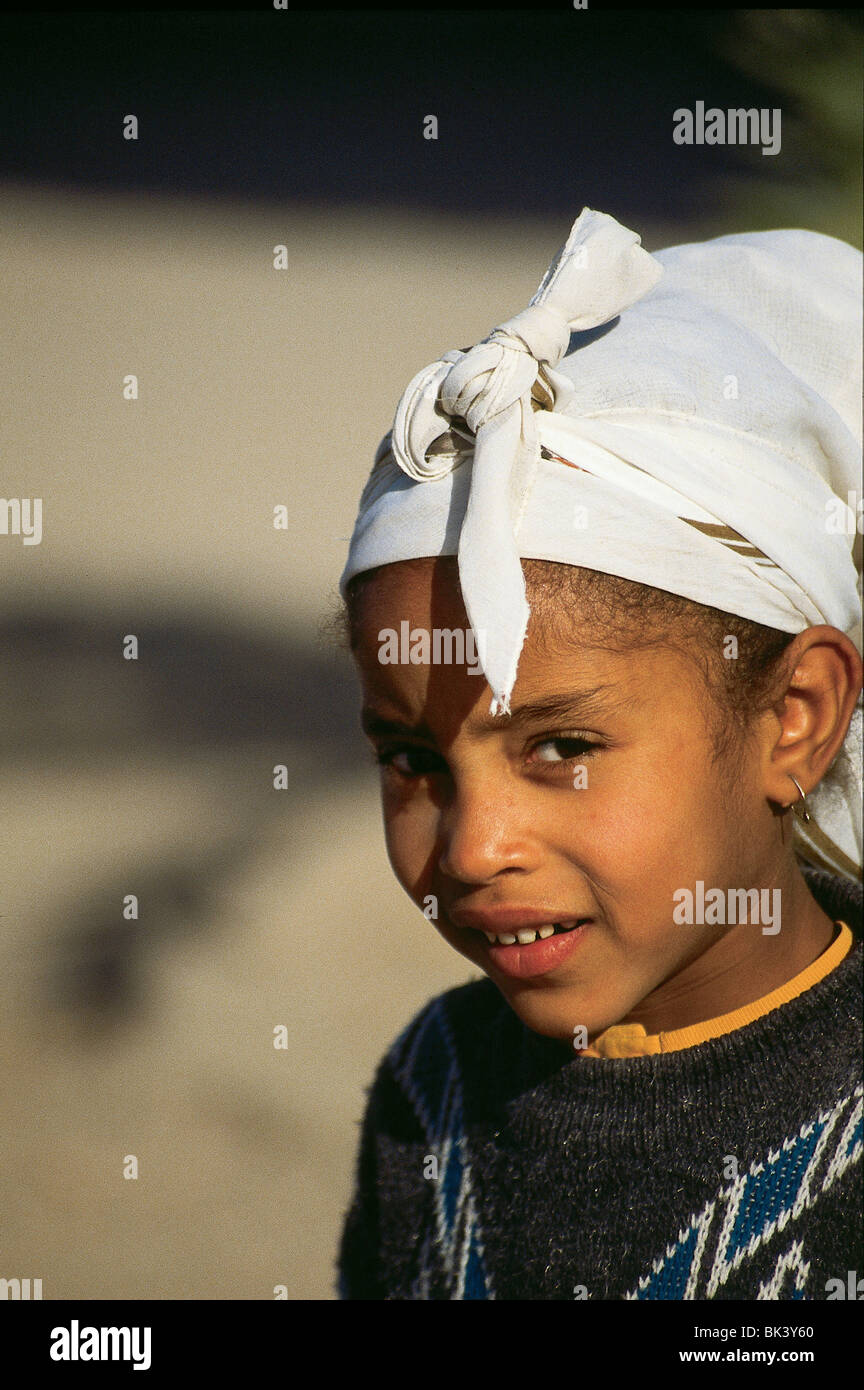 Girl wearing traditional clothing and headscarf in Ouarzazate Province, Morocco Stock Photo