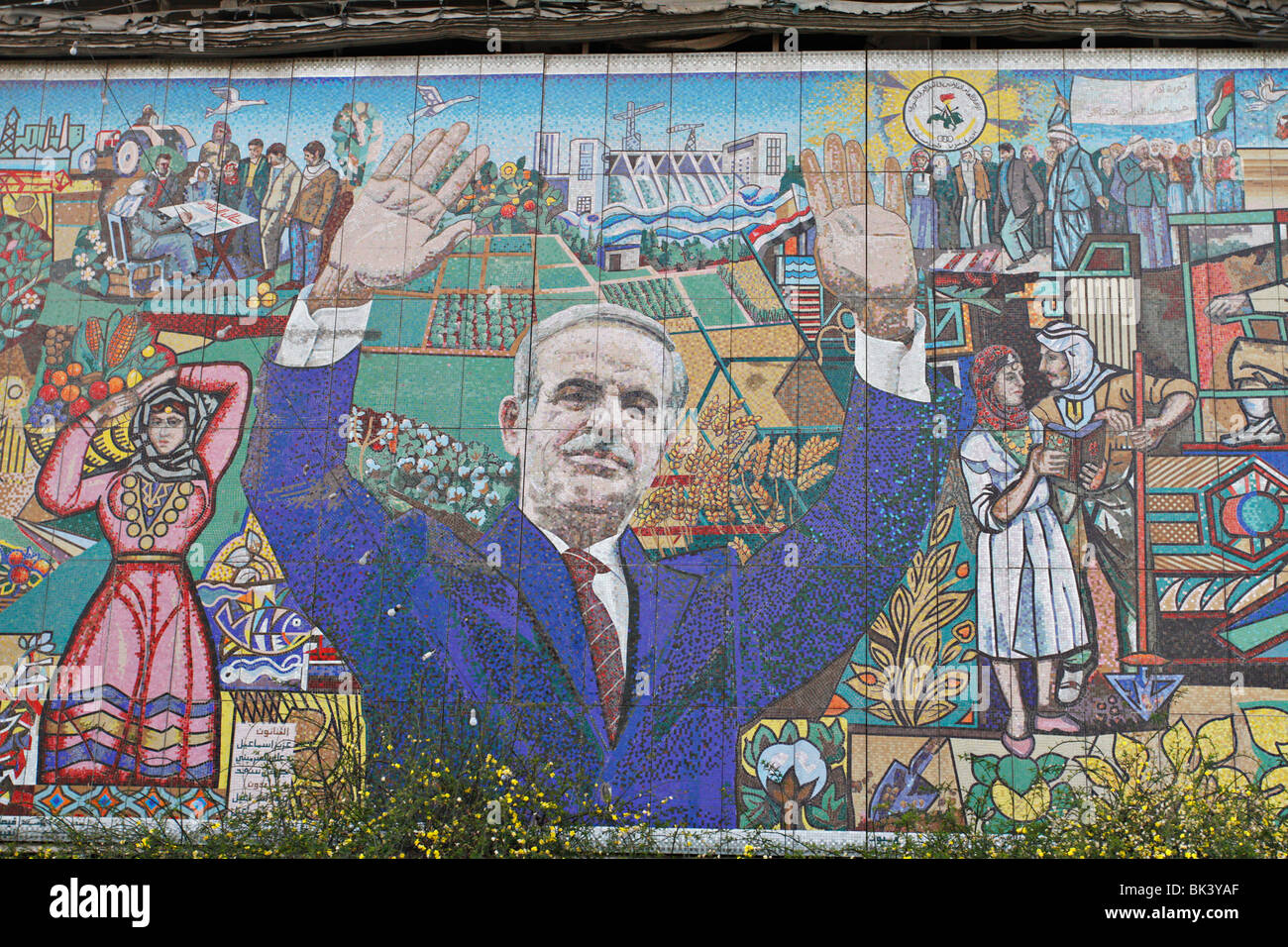 Image of former president of Syria, Hafez al-Assad. It is made from mosaic on a building. - Stock Image