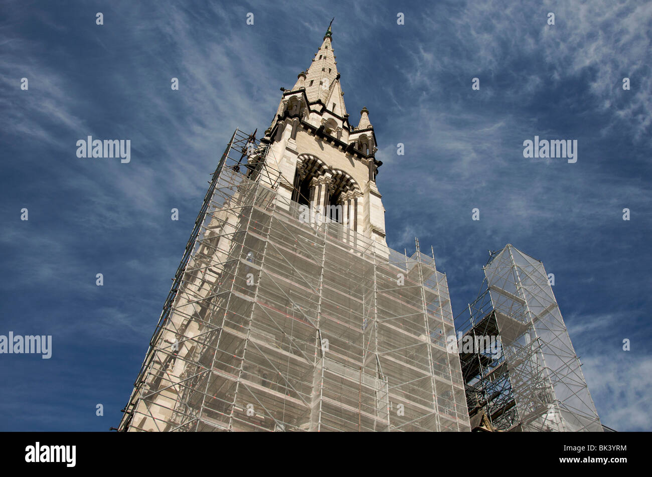 facade in works with a scaffolding  of the cathedral of Moulins. Allier. France. - Stock Image