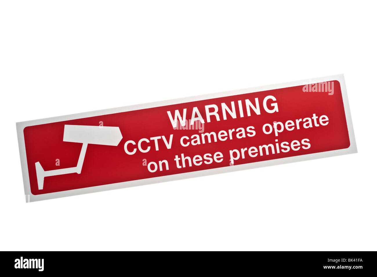 Red warning sticker CCTV cameras operate on these premises - Stock Image