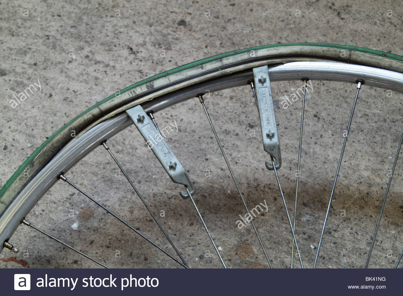 Tyre Levers in Place for the Removal of a Bicycle Tyre - Stock Image