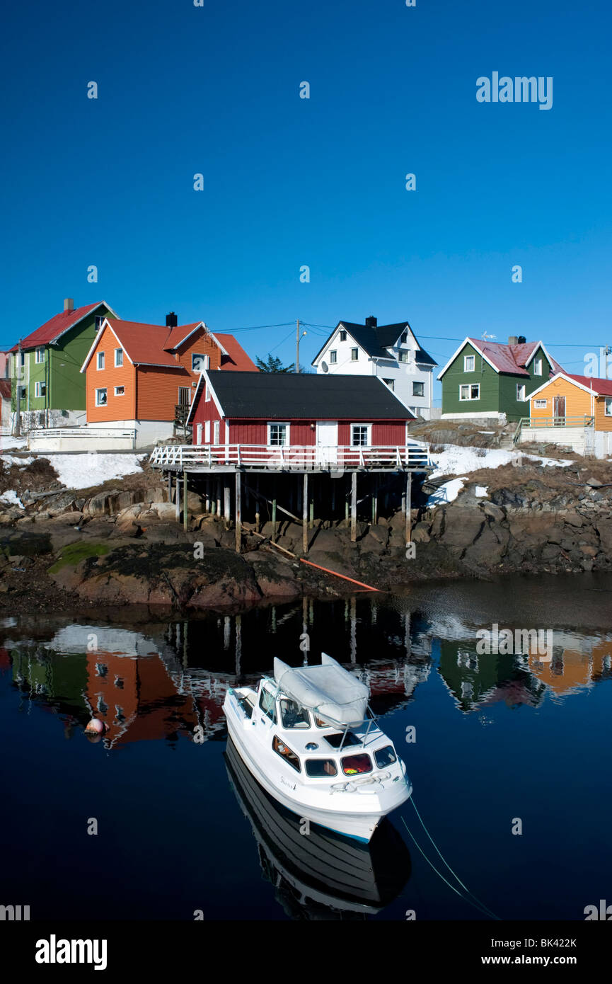 Brightly painted wooden houses in village of Henningsvaer in Lofoten Islands in Norway - Stock Image