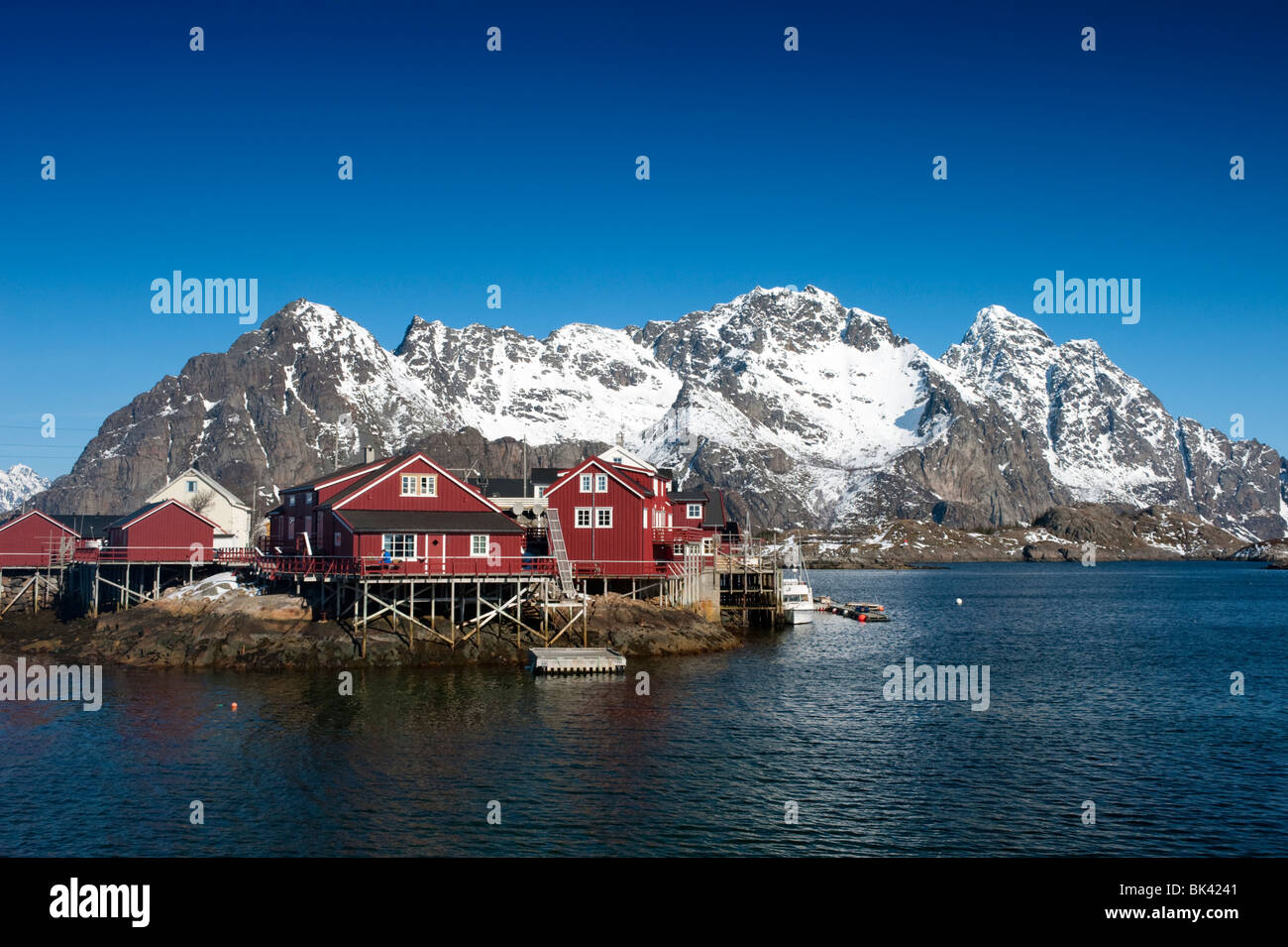 Traditional red wooden Rorbu fishermens` huts in village of Henningsvaer in Lofoten Islands in Norway Stock Photo