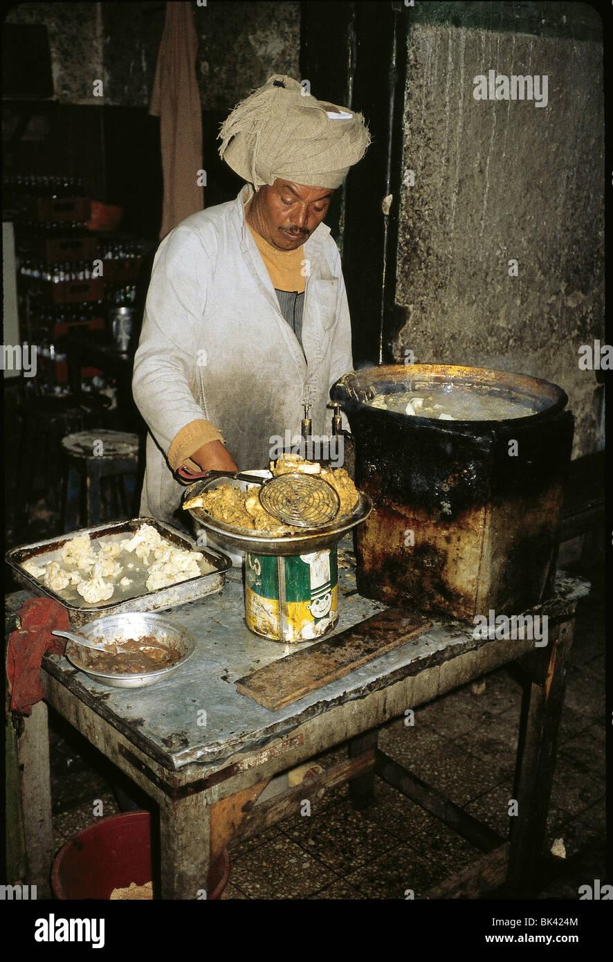 Vendor frying food, Egypt - Stock Image