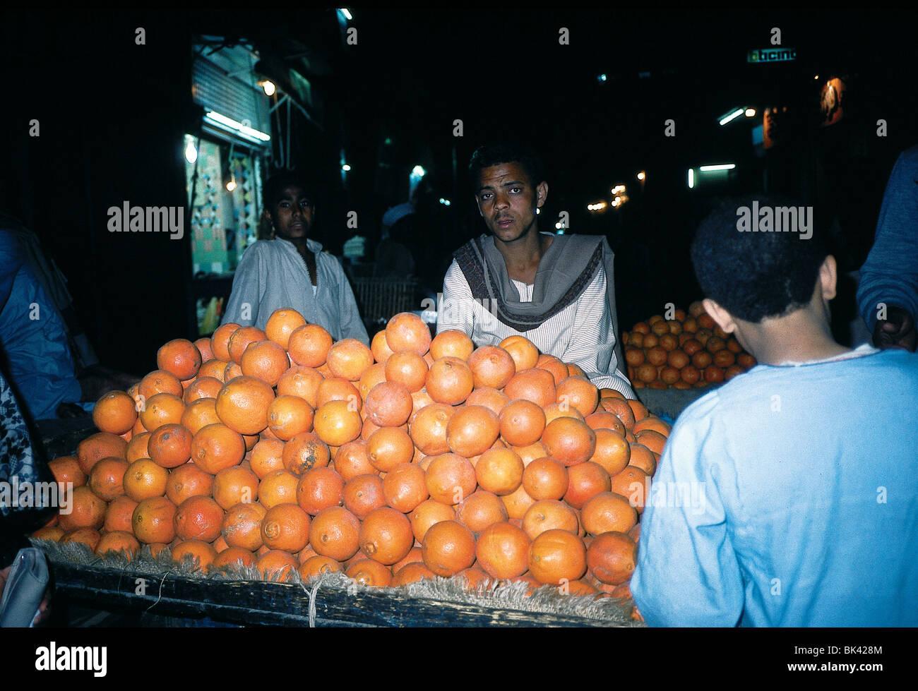 Merchant selling oranges, Egypt - Stock Image