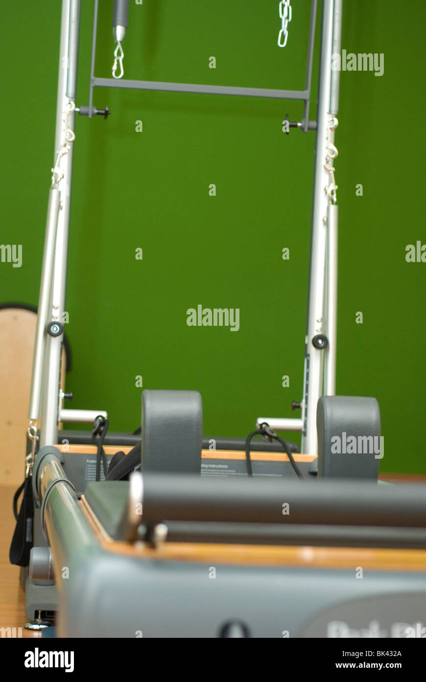 Pilates studio with Barrel, chair, reformer, fit ball, dumbbells - Stock Image