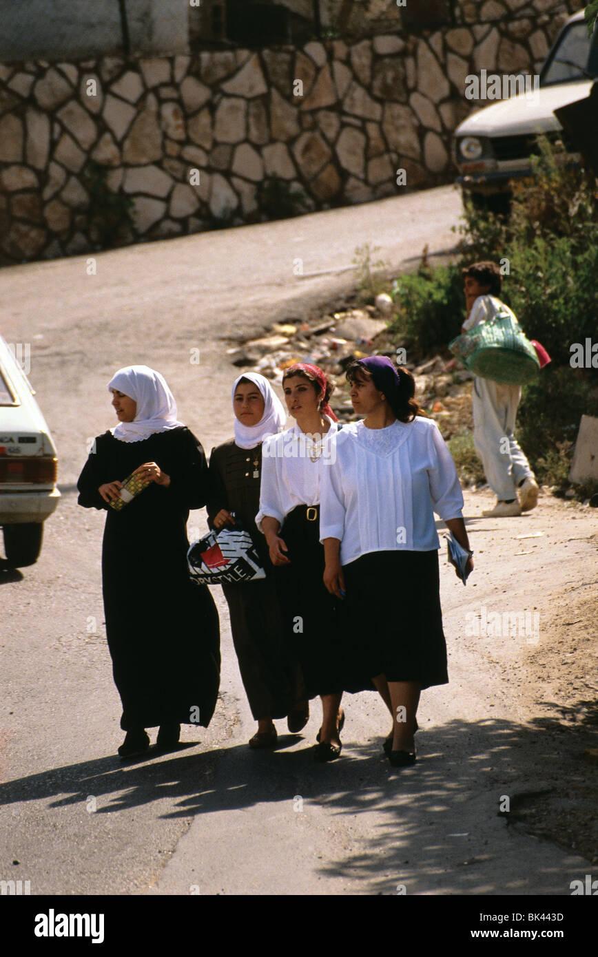 Women walking along a road, Israel - Stock Image