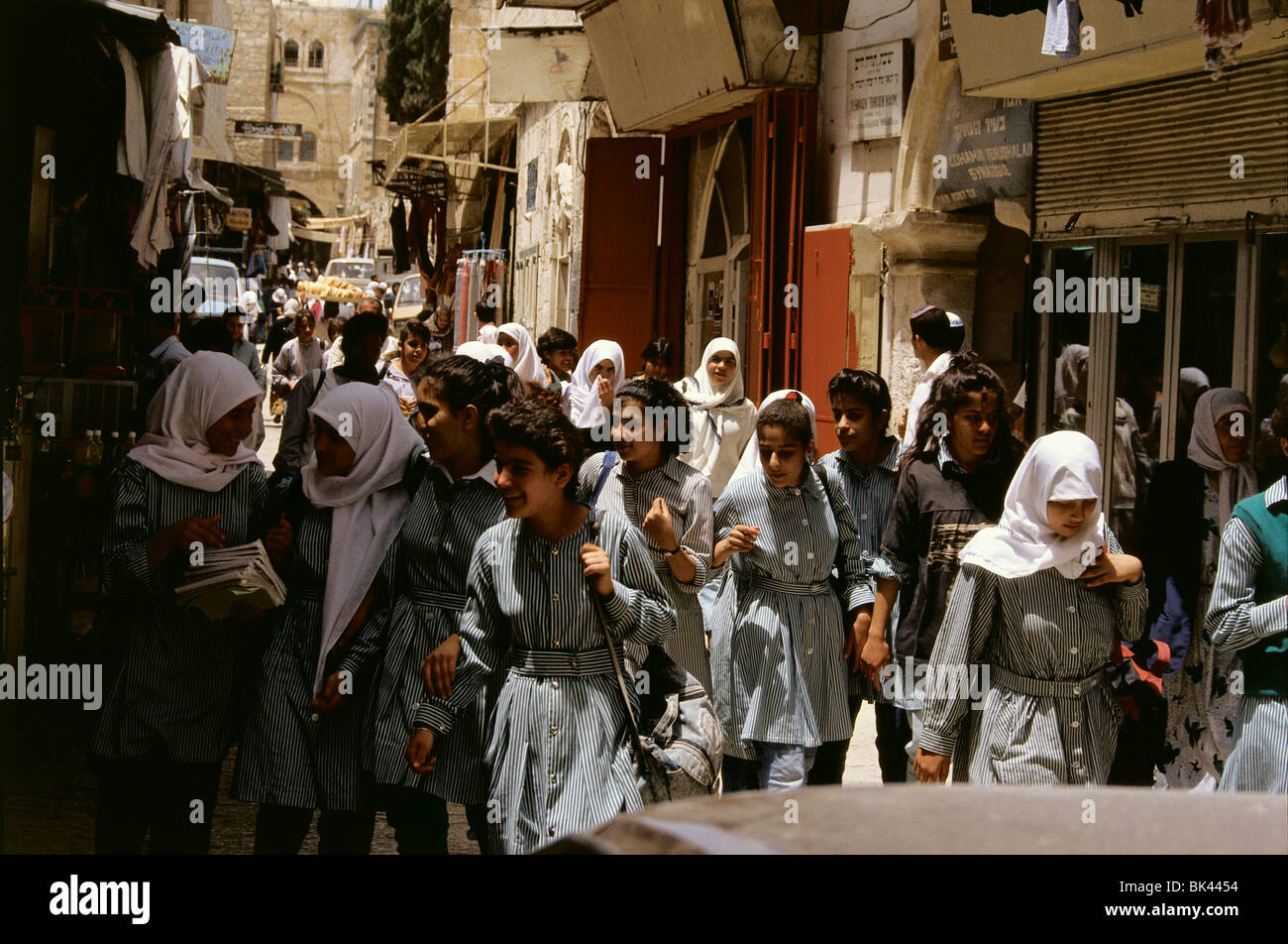 School children walking in the streets of The Old City, Jerusalem - Stock Image