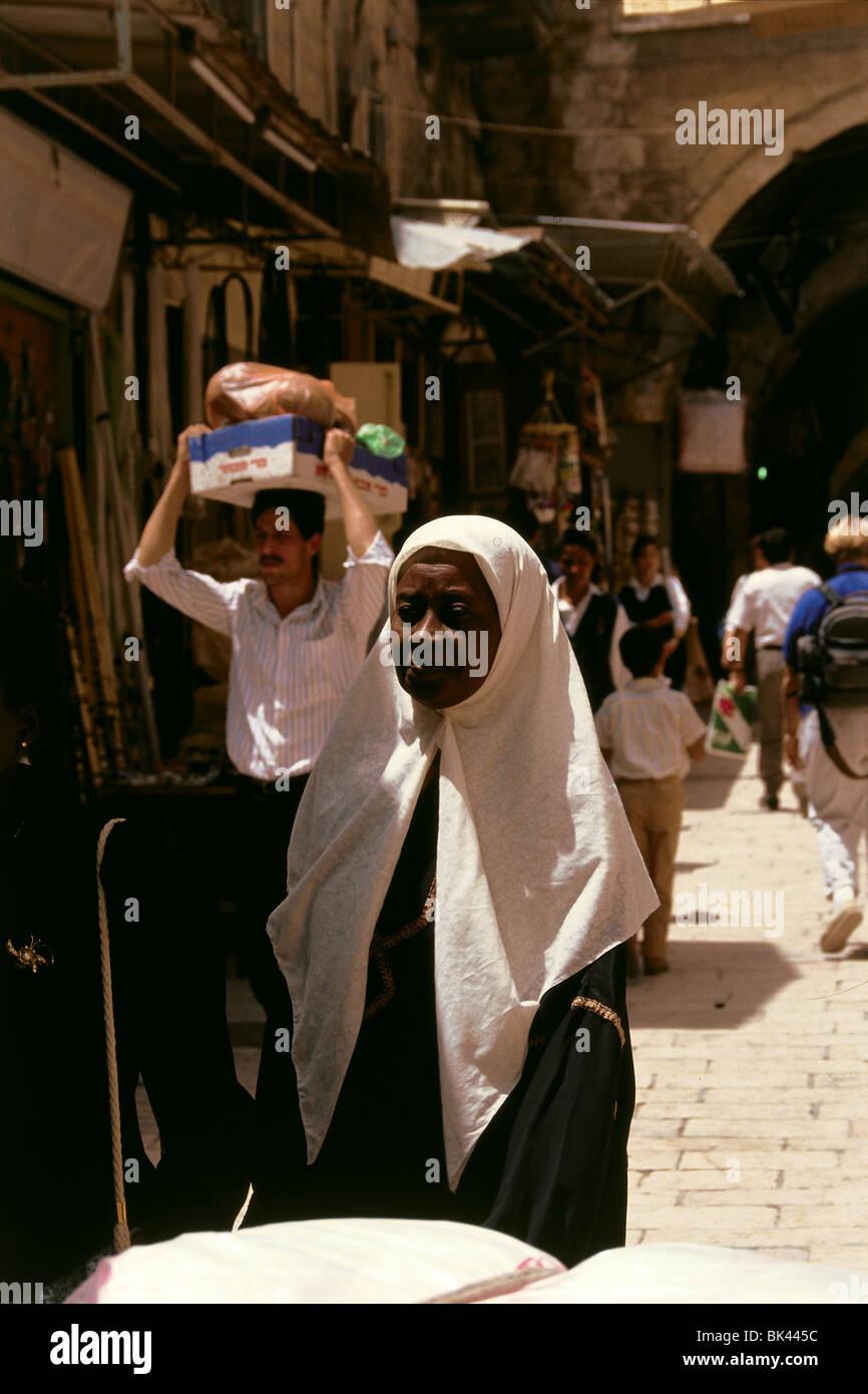 Woman wearing white headscarf in Old Jerusalem, Israel - Stock Image