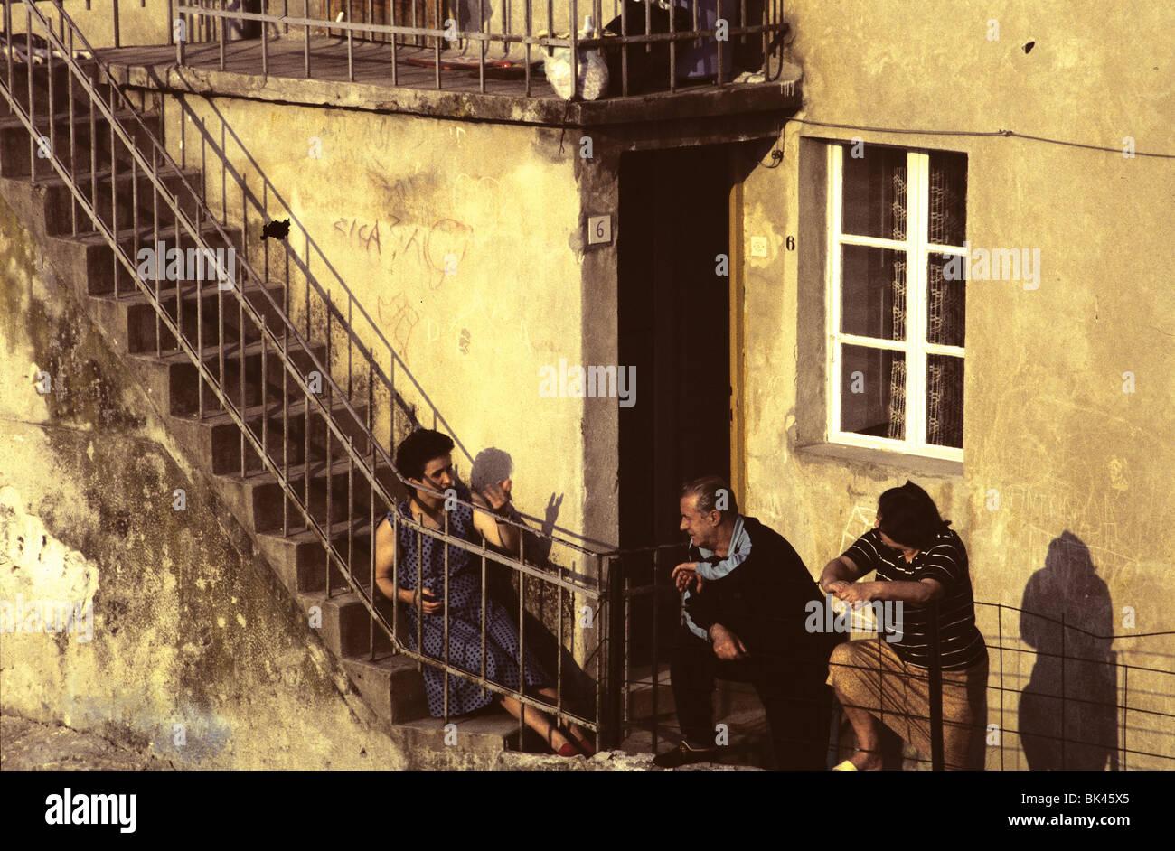 Neighbors having an evening conversion, Croatia - Stock Image