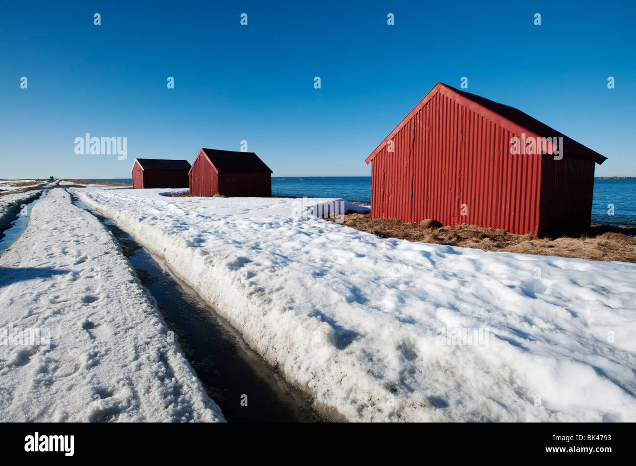 Red hut by sea in village of Eggum on Lofoten Islands in Norway - Stock Image