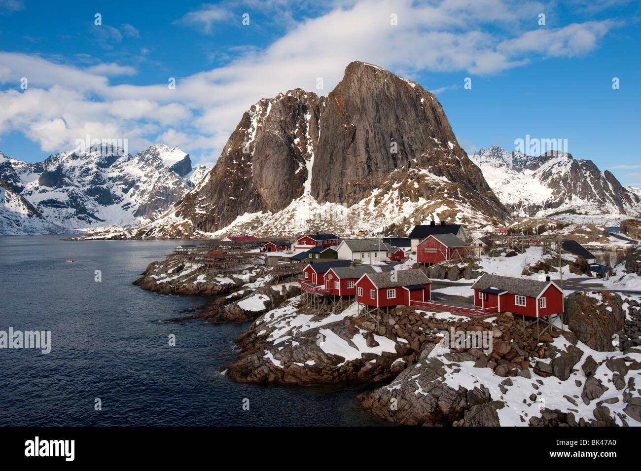 Traditional red wooden Rorbu fishermen`s huts in village of Hamnoy on Moskenesoya Island in Lofoten Islands in Norway - Stock Image