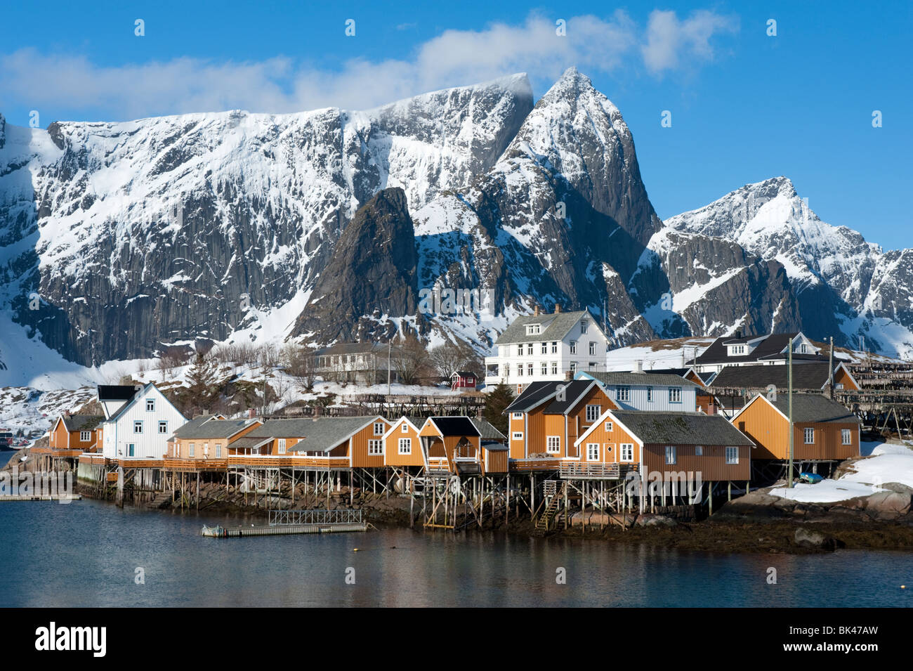 Traditional wooden Rorbu fishermen`s huts in village of Sakrisoy on Moskenesoya Island in Lofoten Islands in Norway - Stock Image