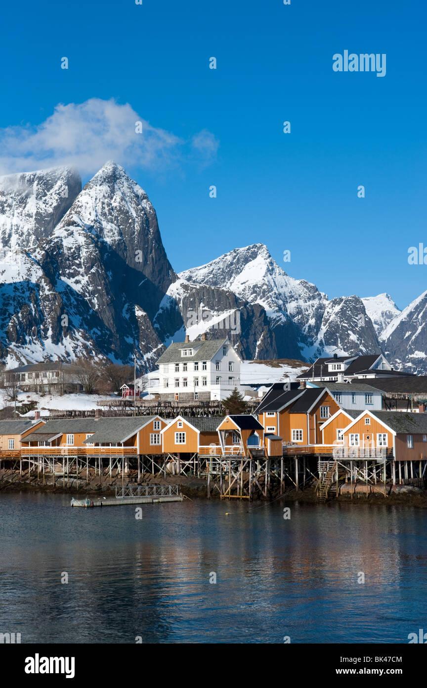 Traditional wooden Rorbu fishermen`s huts in village of Sakrisoy on Moskenesoya Island in Lofoten Islands in Norway Stock Photo