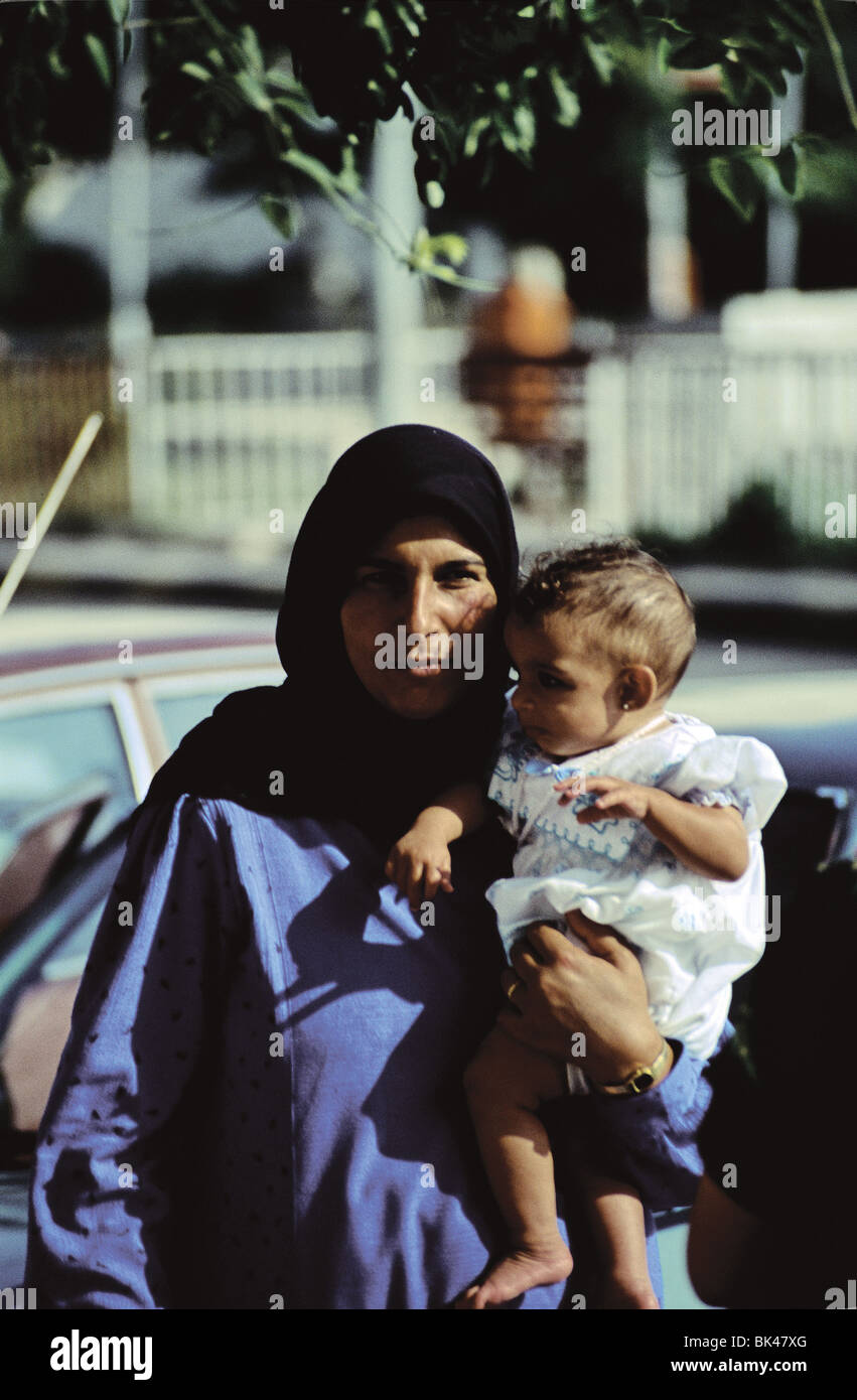 Portrait of a woman holding a baby, Jordan - Stock Image