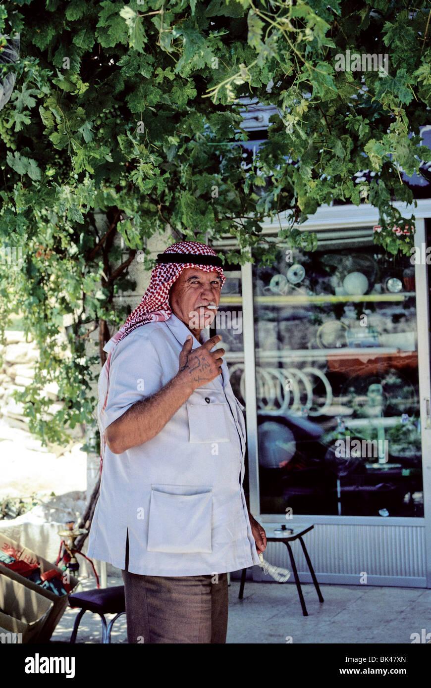 Portrait of a Jordanian man smoking a cigarette, Jordan - Stock Image
