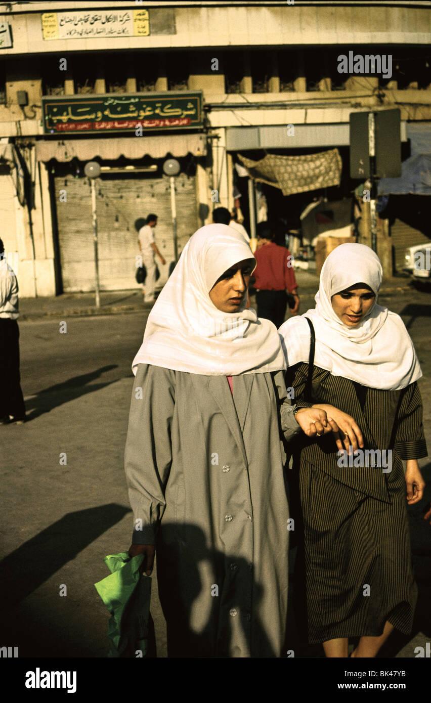 Two women wearing white headscarves, Amman, Jordan - Stock Image