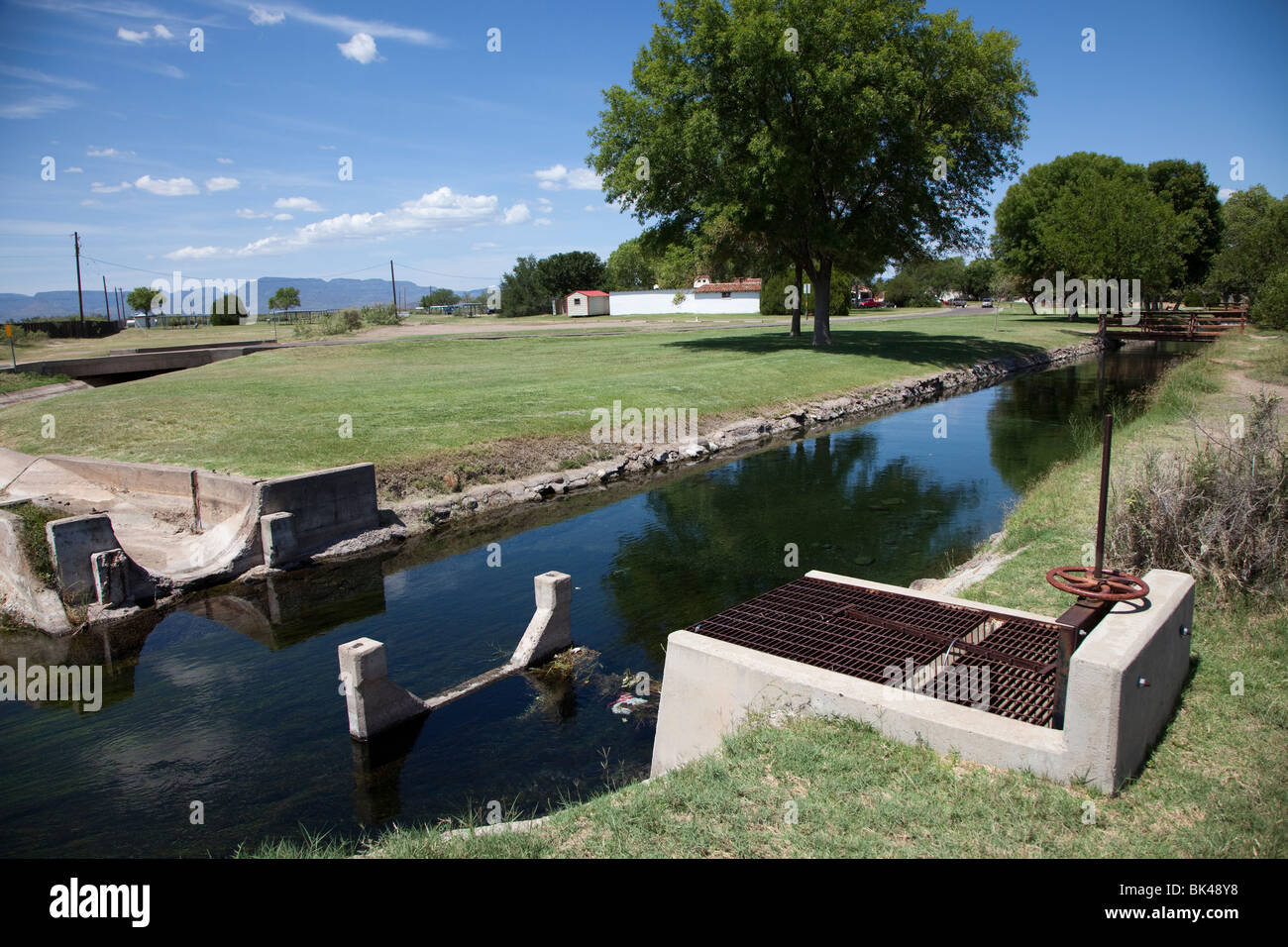 Sluice gate in canal fed by San Solomon Springs Balmorhea state park Texas USA - Stock Image