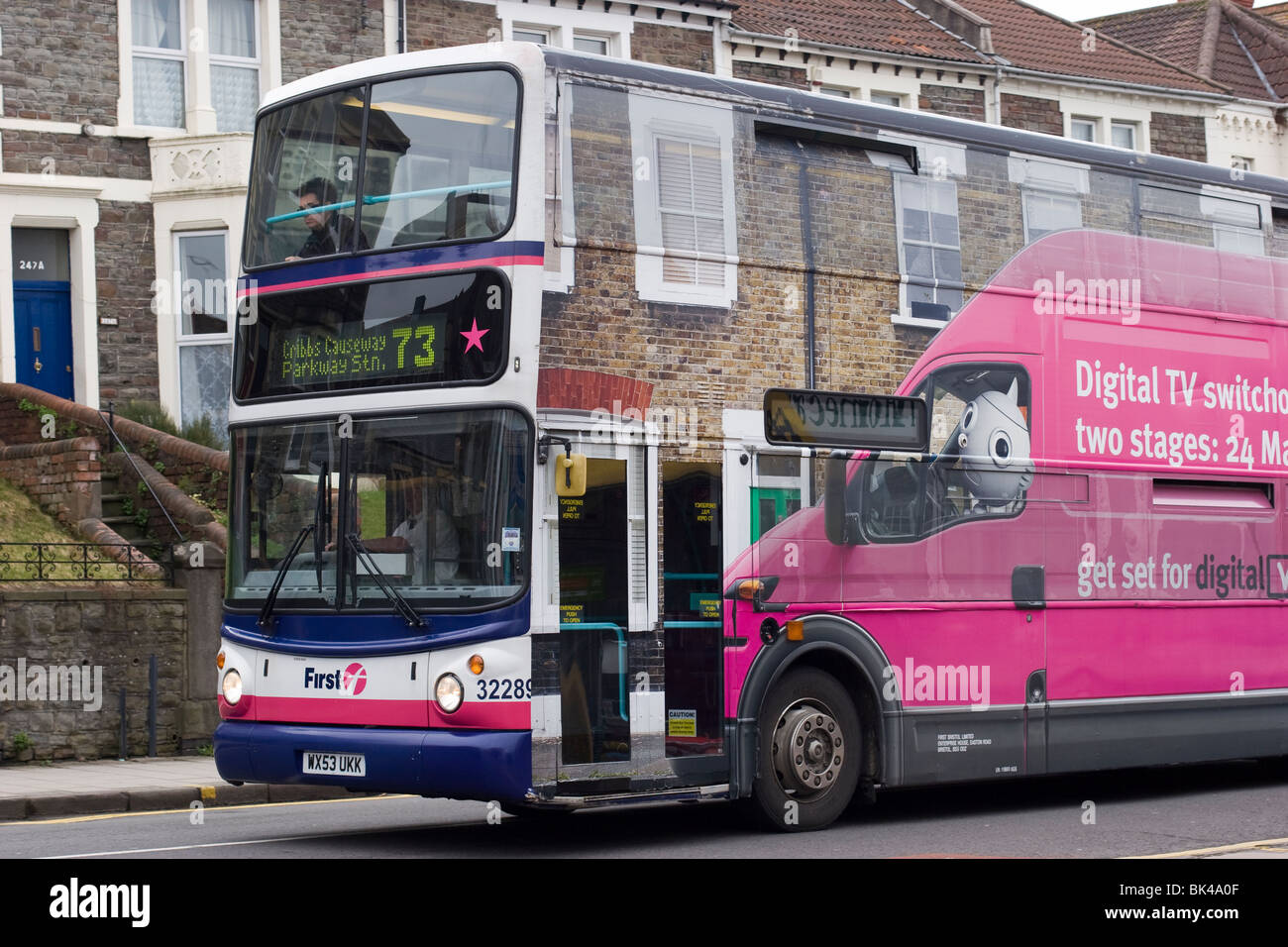 A bus adorned with an advert about digital TV switchover.  Gloucester Road, Bristol, England. - Stock Image