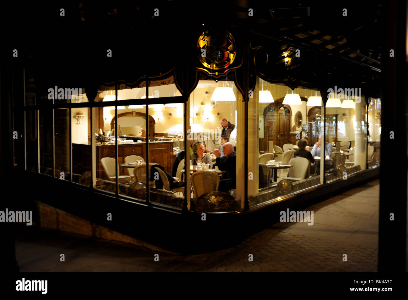 Customers looking out the window of Bettys Cafe and Tea Rooms in Harrogate Yorkshire UK - Stock Image