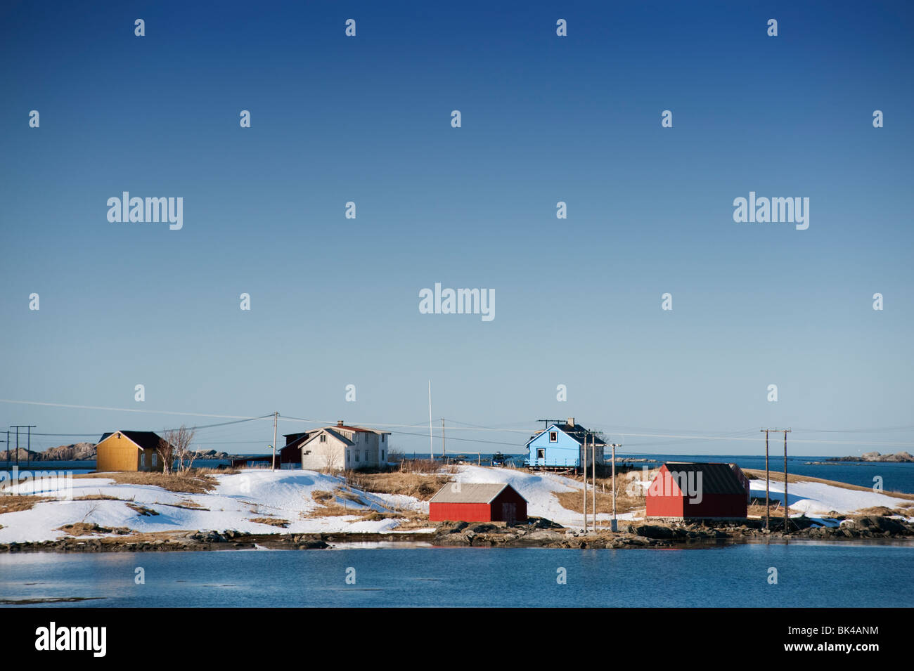 Brightly painted wooden houses by the sea in Eggum on Lofoten Islands in Norway - Stock Image