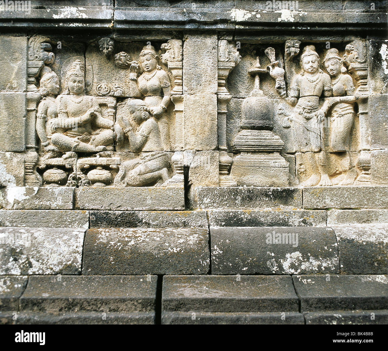 9th Century Stone relief carvings tell stories of Buddha's life at the Buddhist temple Borobudur in Central - Stock Image