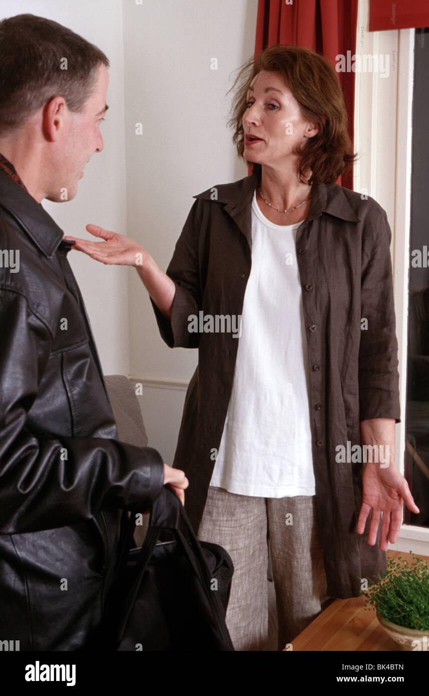 Angry couple 40s, woman frustrated with man - Stock Image