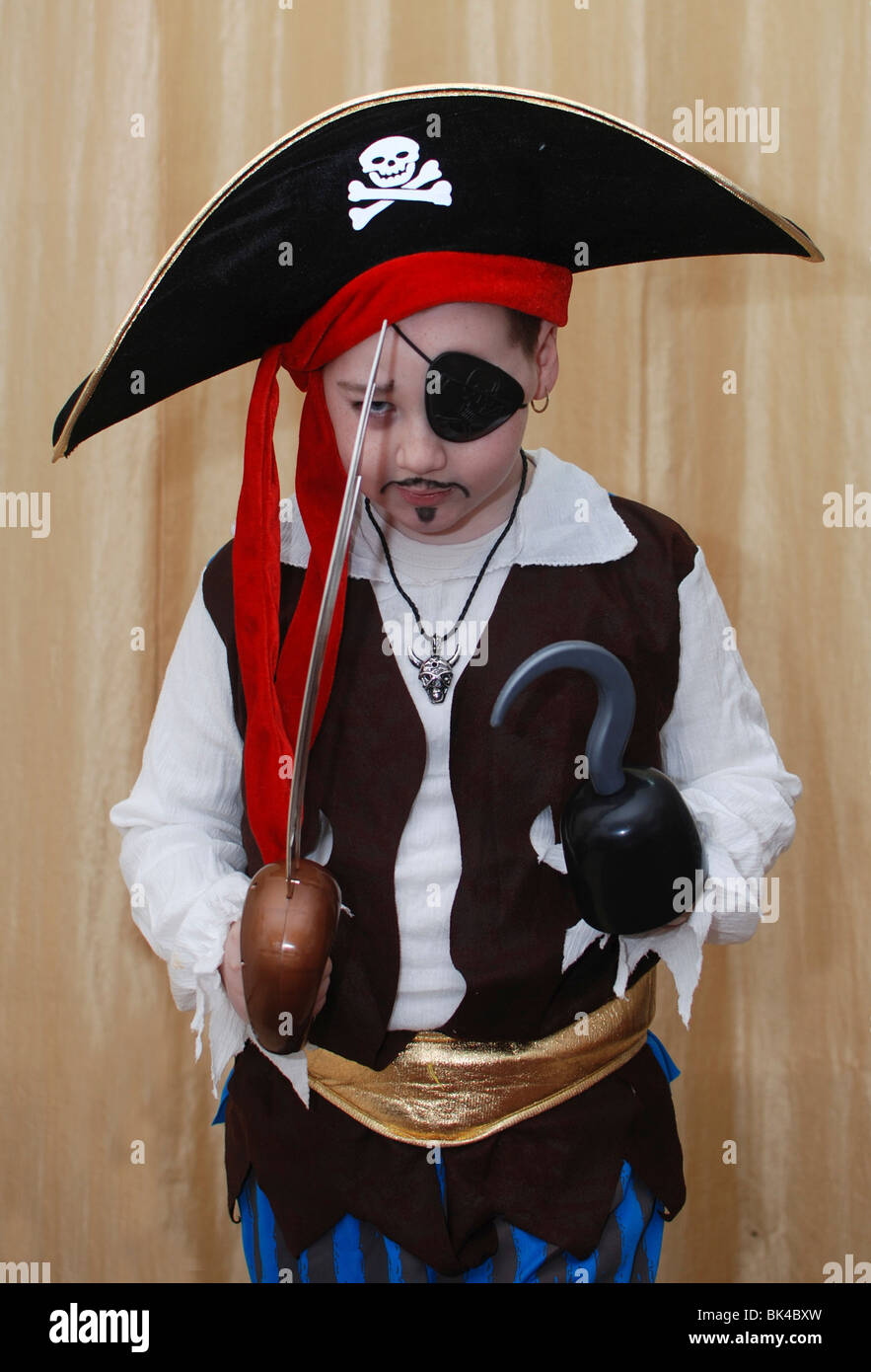 Young boy of 7 dressed up as a pirate for the Jewish celebration of Purim - Stock Image